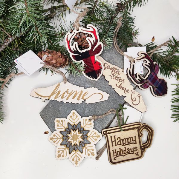 Wooden Christmas ornaments from hand drawn designs made in Nanaimo Vancouver Island Canada