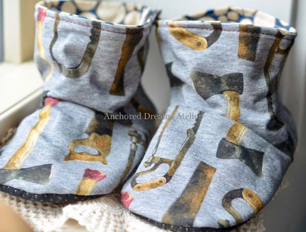 axe and saw pattern baby booties, product made in Canada on Vancouver Island