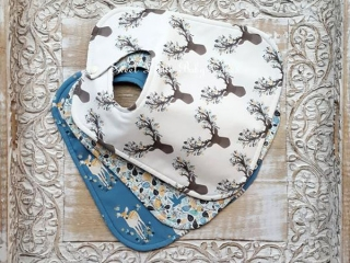 Cloth baby bibs with deer and bird patters, product handmade in Courtenay, B.C., Canada by Sweet Little Baby Cakes