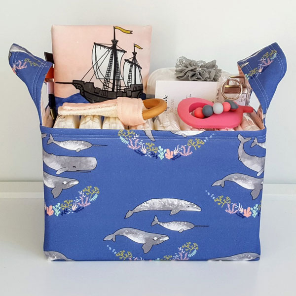 Variety of baby items made on Vancouver Island, Canada. Marine themed baby shower gift set with whales