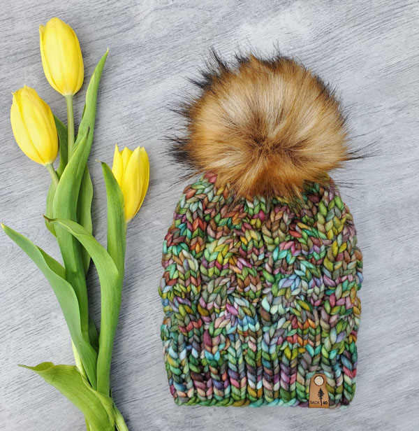 earth tone pom pom touque, product of BC made by Back 40 Design