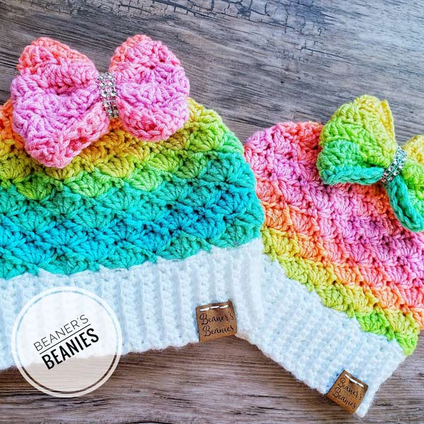 rainbow knit toques/beanies with bows, hand made in Ladysmith on Vancouver Island by Beaner's Beanies