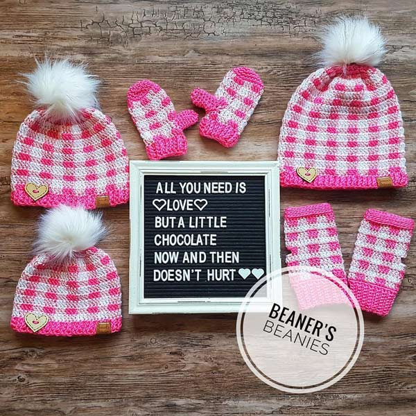 Pink and white toques, mits, and warmers hand made in Ladysmith by Beaner's Beanies