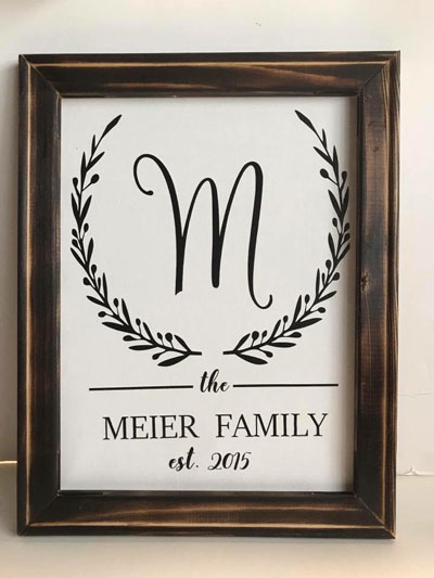 Custom made sign saying the family est. , locally made on Vancouver Island