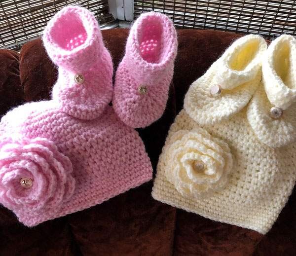 Pink and white baby booties and hats made on Vancouver Island by knitter Crazy Crocheter