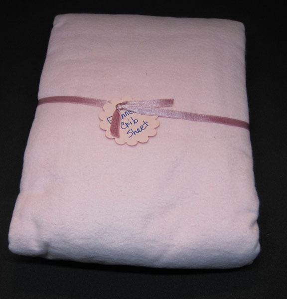 pink Canadian made flannel crib sheet, made in Courtenay B.C.