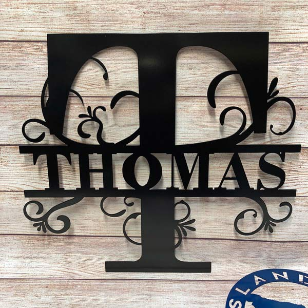 "custom metal art Canadian made sign saying ""Thomas"" handcrafted by Island Metal Arts"