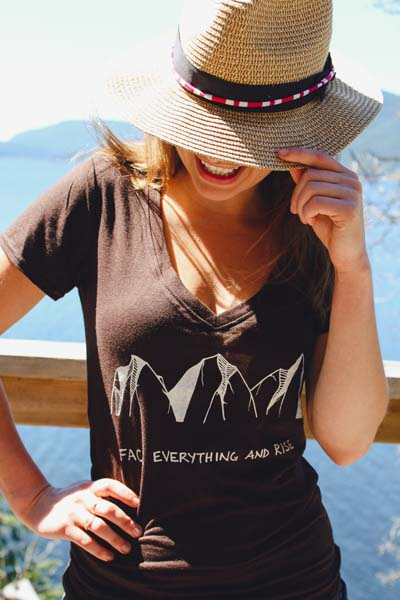 woman wearing mountain print t shirt made in Canada, printed on Saltspring Island