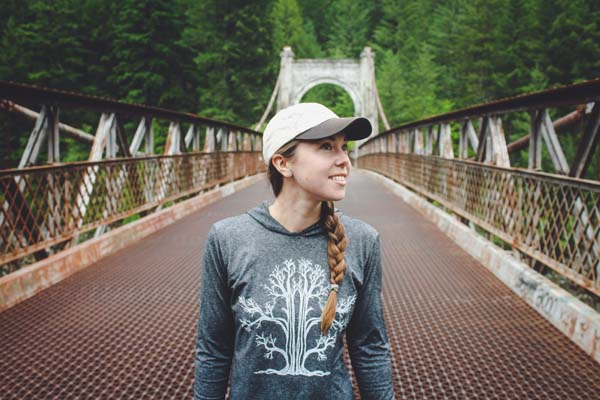woman wearing tree print athletic hoodie printed on Saltspring Island