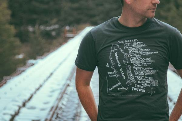 man wearing Vancouver Island tshirt with towns listed on bamboo shirt