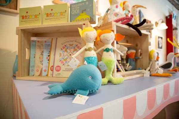 Books and hand made stuffies interior of Little Village Store, local Vancouver Island retailer in Cumberland