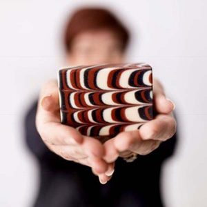 woman holding Haida Potlatch Bar, handmade soap from Vancouver Island