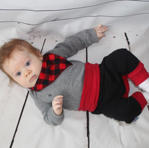 baby wearing grow along pants, red and black, and plaid bib, handmade in Sooke, B.C., on Vancouver Island by Sugar Sandwich
