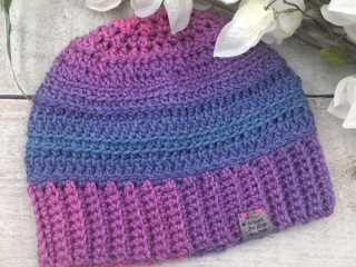 pink, purple, and blue beanie, product made by Vancouver Island knitter/crocheter Through the Loop