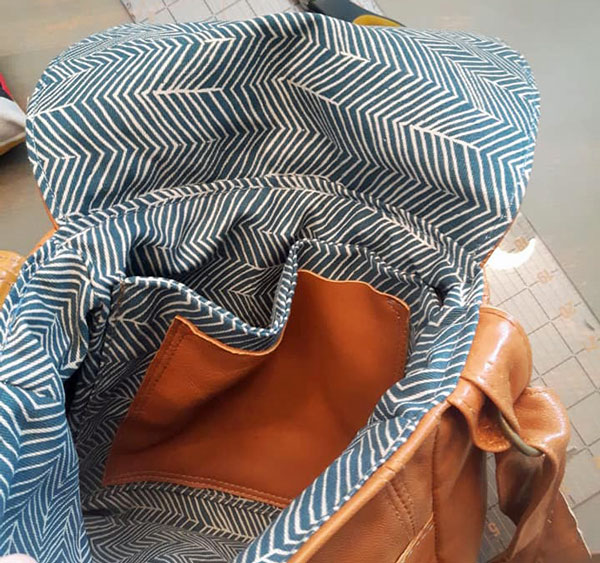 striped pattern inside of upcycled leather handbag, handmade on Vancouver Island by A.D.E Designs