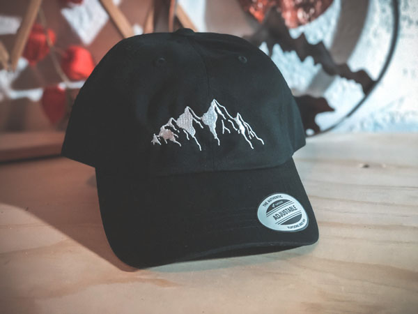 hat with mountain image, product of Vancouver Island