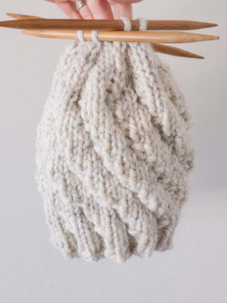 cream coloured toque being knit by Blackbird Creative on Vancouver Island