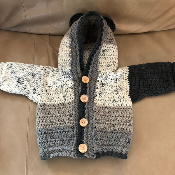 Knitted baby sweater made on Vancouver Island in Victoria/Duncan by Creative Hands