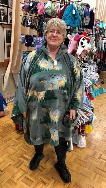 Image of Creative Hands designer Linda wearing poncho