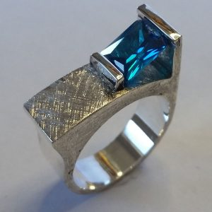silver ring with blue cubic zirconia, made by Vancouver Island jewelery maker European Goldsmith