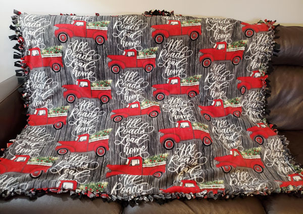 Red Truck fleece knotted blanket made on vancouver island