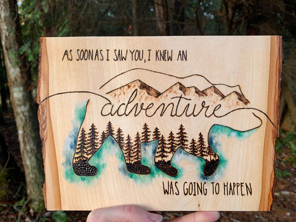 "Vancouver Island wood burning of bear with ""as soon as I saw you, I knew an adventure was going to happen"""