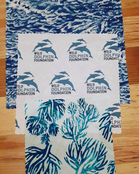beeswax wraps printed with corporate logo of Wild Dolphin Foundation, ecofriendly advertising, made by Island Reveries on Vancouver Island