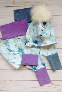 Blue and white floral printed grow with me pants and pom pom hat, made on Vancouver Island by Kid-o's