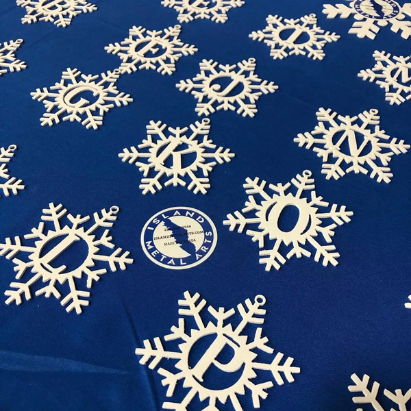 Metal monogrammed snowflake ornaments made in Canada on Vancouver Island