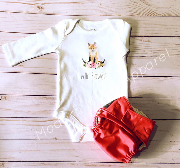 "Vancouver Island printed onesie with a fox, flowers, and saying ""wildflower"" by Modern Minis"