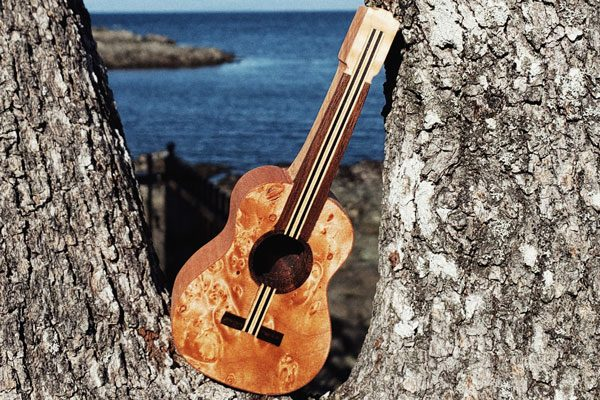wooded guitar pipe, handcrafted on Vancouver Island Canada by Nomadik Creative