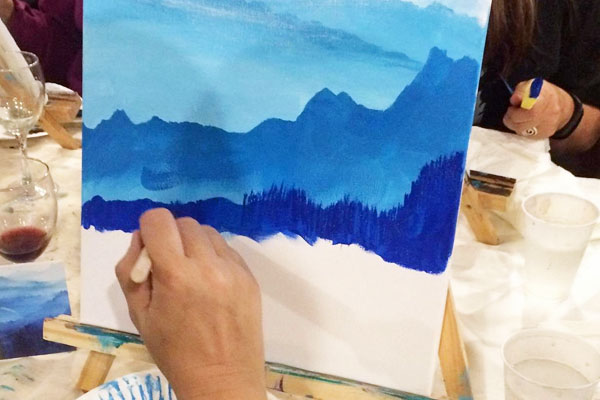 person learning to paint in Qualicum Beach at Oceanside Art Studio painting classes