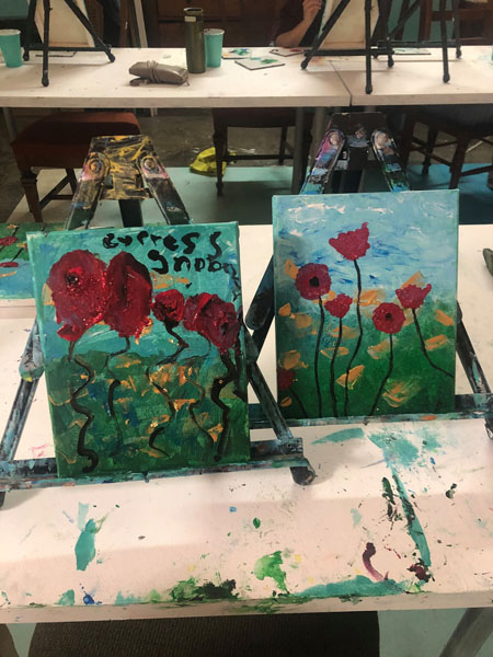 Paintings of flowers at parent and tot painting classes in Qualicum Beach at Oceanside Art Studio