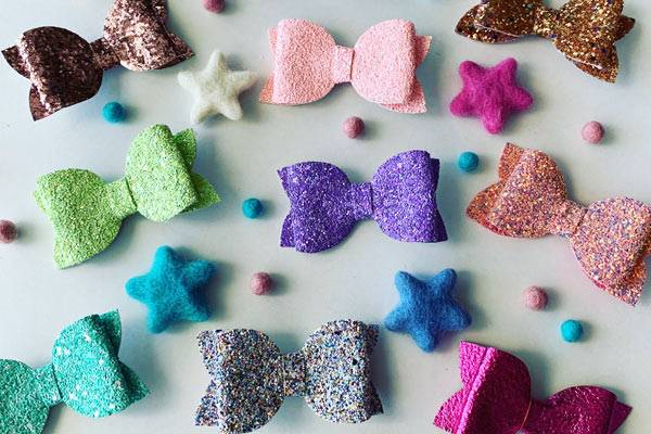 collection of sparkly hair bows, product handmade on Vancouver Island by Little Maven's Bow Co