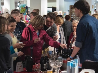 market goers enjyoing wine samples at VIM craft market