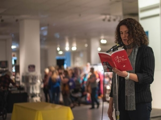 author doing a reading at VIM craft market on Vancouver Island