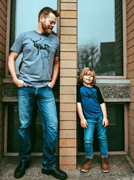 father and son wearing deer and bike print Vancouver Island t-shirts by smoking lily